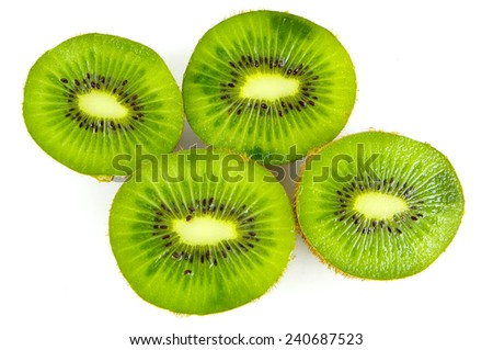 Cut tropical fruit, juicy green kiwi on a white background - stock photo