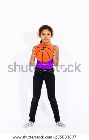 Cute active american girl with basketball ball isolated on white - stock photo