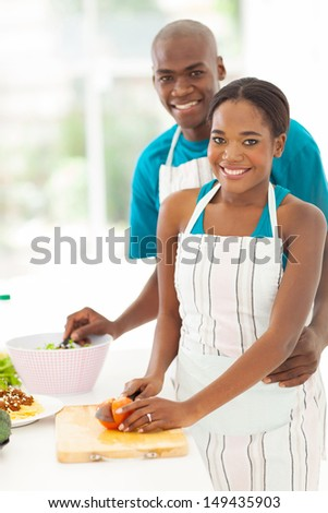 cute african american couple cooking healthy food together - stock photo