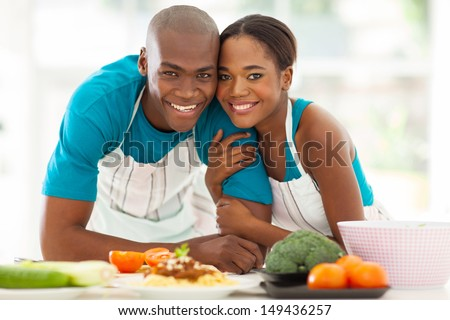 cute african american couple in home kitchen - stock photo