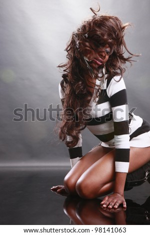 Cute African American shakes her hair - stock photo