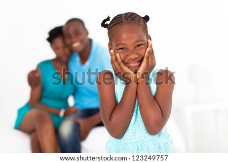 cute african little girl standing in front of parents - stock photo