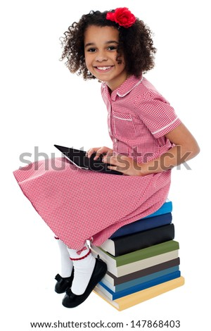 Cute african school kid using tablet device - stock photo