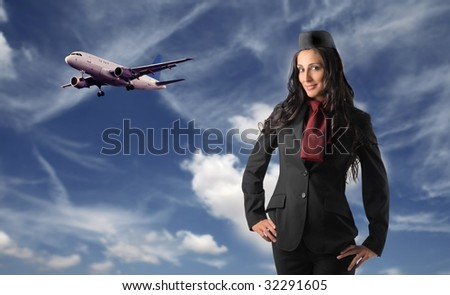 cute air hostess with airplane flying on the background - stock photo