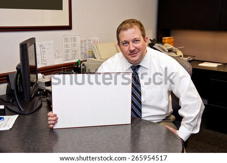 Cute Amused  Businessman With Blank Sign And Smiling - stock photo