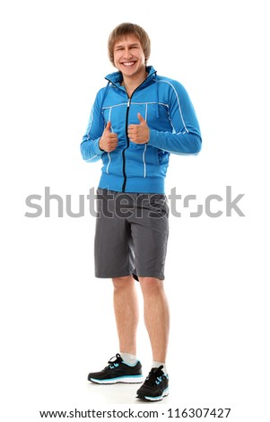 Cute and attractive sport guy smiling and showing thumbs up isolated on a white - stock photo