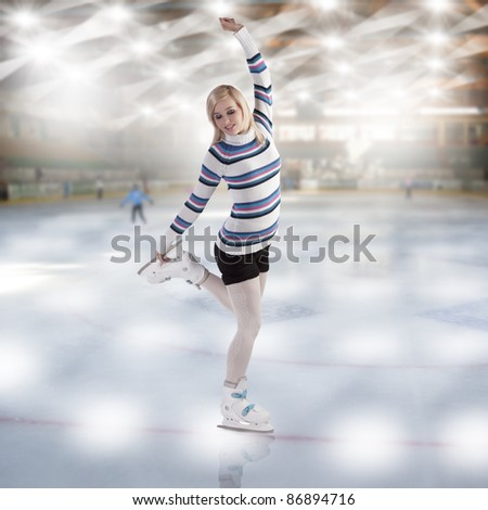 cute and blond girl with shorts and a nice sweater making a ice skating figure - stock photo
