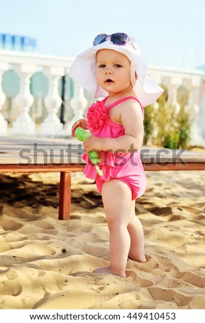 cute and fashion baby girl on the beach - stock photo