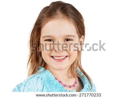 Cute and natural little blond girl smiling - stock photo