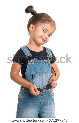 Cute and stylish baby girl  with sunglasses posing in studio.Isolated - stock photo