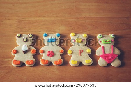 cute animal cookies on red plate with effect color - stock photo