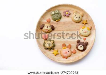 Cute animals cookies on a wood plate. - stock photo