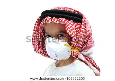 cute arabic muslim boy wearing disposable face mask on white background. - stock photo