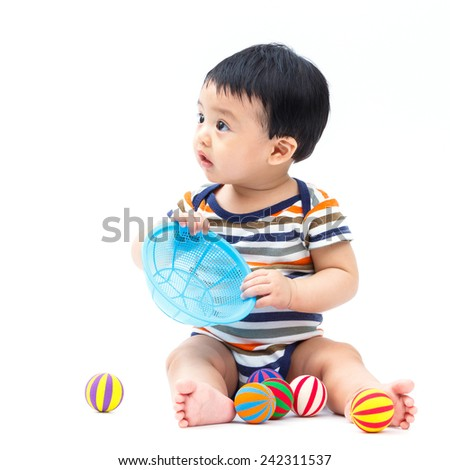 Cute asian baby playing toy isolated on white - stock photo