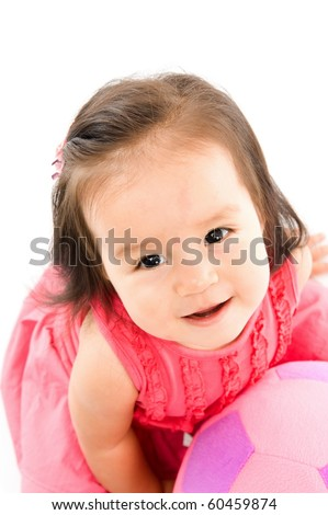 Cute asian baby smilling holding a plush ball . - stock photo