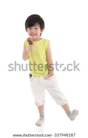 Cute asian boy eating roasted chicken leg - stock photo