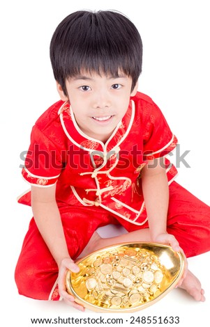 Cute Asian Boy In Tradition Chinese Cheongsam Isolated On White Background : Chinese New Year Concept - stock photo