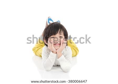 Cute asian boy lying on white background isolated - stock photo