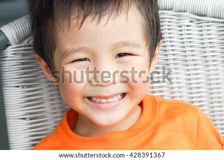 Cute Asian boy smiling - stock photo