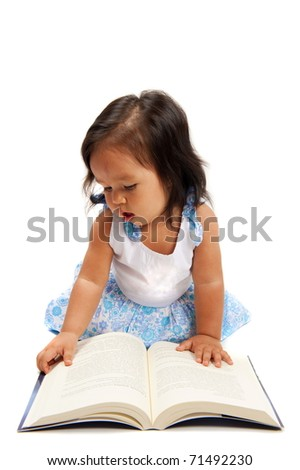 Cute asian child girl looking at books . - stock photo