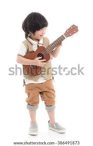 Cute asian child holding ukulele on white background isolated - stock photo