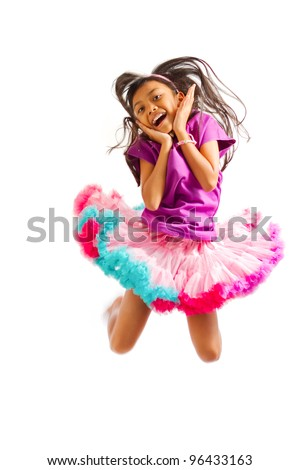 cute asian ethnic girl with tutu skirt jump high isolated on white - stock photo