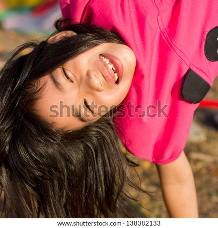 cute asian girl play hanging head. - stock photo