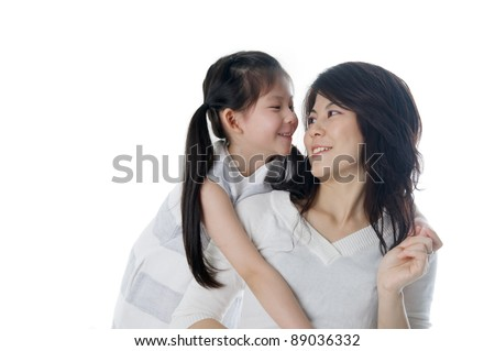 cute asian girl talking to her mother - stock photo