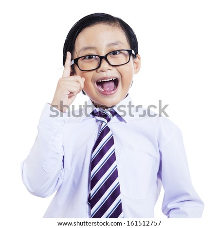 Cute asian schoolboy having an excellent idea, isolated on white background - stock photo