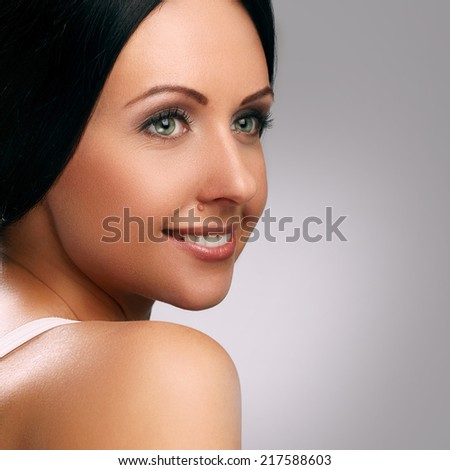 Cute, attractive brunette with wide smile - stock photo
