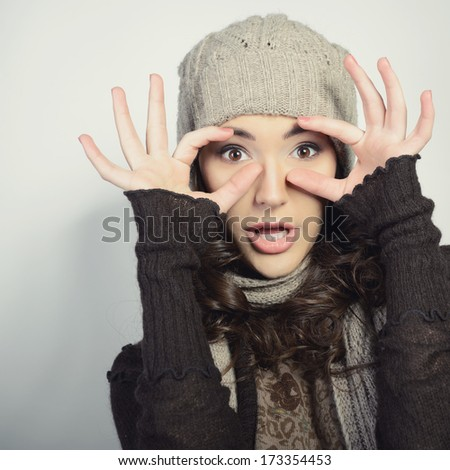 Cute attractive fashion young girl gesturing and looking at camera,  in warm clothes  - stock photo
