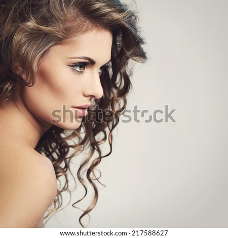Cute, attractive girl on a gray background - stock photo
