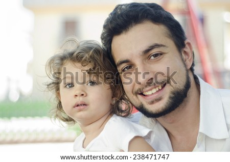 Cute baby and father posing in outdoors image - stock photo