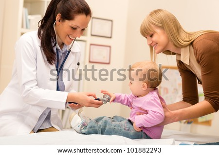 Cute baby being examine by pediatrician with stethoscope - stock photo
