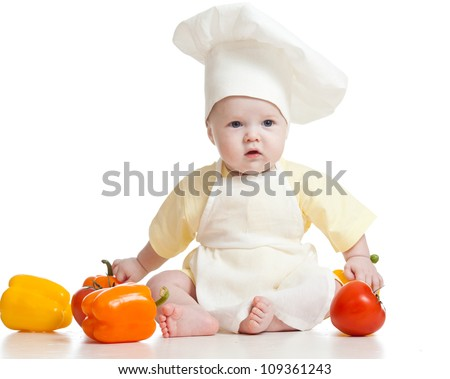 cute baby boy chef with healthy  food vegetables, isolated on white - stock photo