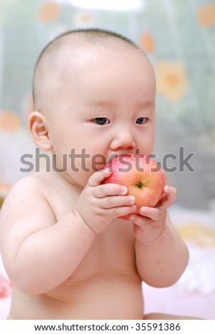 cute baby boy  eat red apple - stock photo