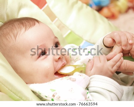 Cute baby boy eating - stock photo