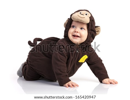 Cute baby boy in monkey costume looking up over white - stock photo