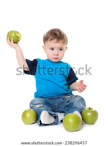 Cute baby boy kid eating and playing with green apples isolated on white background - stock photo