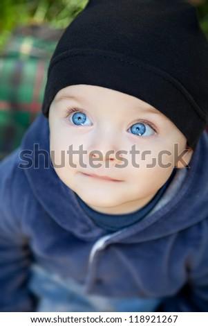Cute baby boy outdoor - stock photo