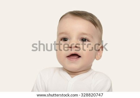 Cute baby boy smiling. Adorable happy laughing baby portrait isolated on white. - stock photo