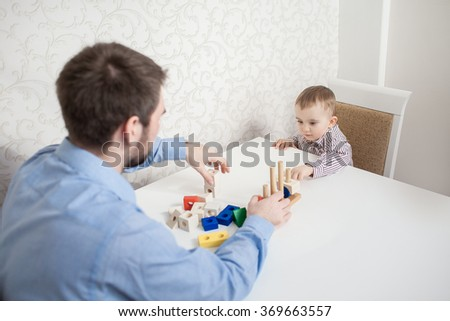 Cute baby boy with blocks - stock photo