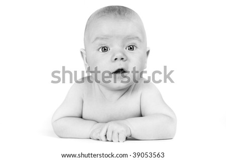 Cute baby boy with surprised look on his face - stock photo