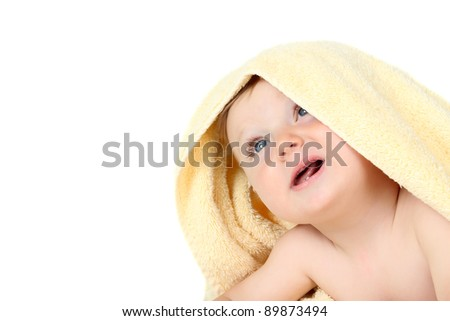 Cute baby boy wrapped in a yellow towel - stock photo