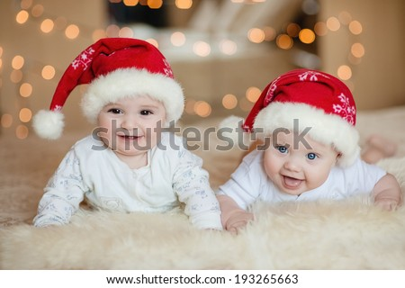 Cute baby boys in Santa hat - stock photo