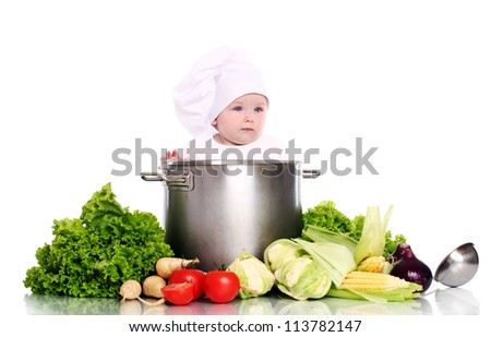 Cute baby chef with big pot and vegetables over white background - stock photo