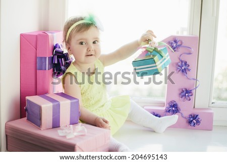 cute baby girl celebrating first birthday - stock photo