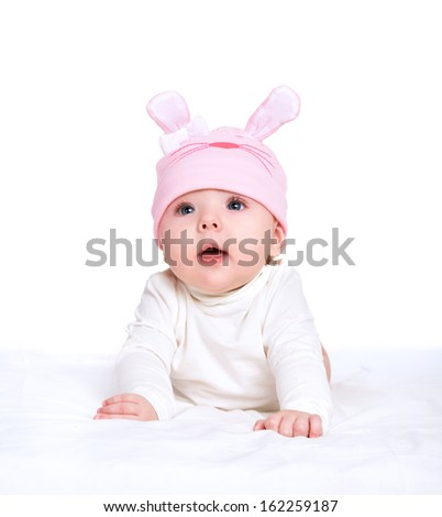 cute baby girl in a pink hat with rabbit ears isolated on white background - stock photo