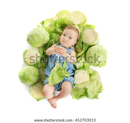 Cute baby girl in cabbage, isolated on white - stock photo