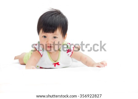 Cute baby girl in white dress on a white background. - stock photo